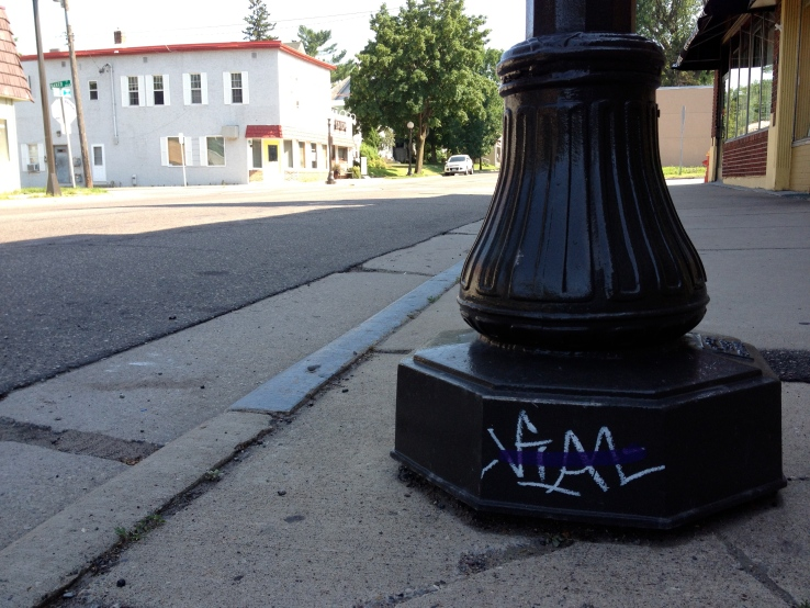 Someone's been tagging the light posts up and down Smith Avenue.